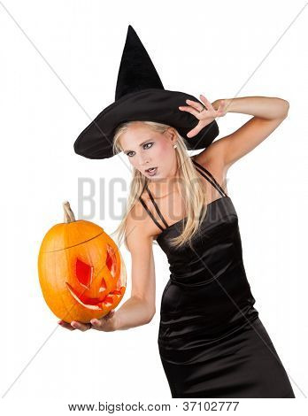 Beautiful sorceress with pumpkin. isolated on white background