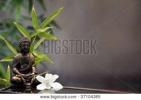 Buddha with orchid flower and bamboo.