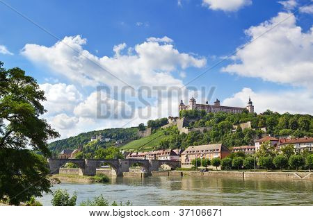 Wuerzburg with view over the Main River towards the Alte Mainbruecke and the Festung Marienberg.