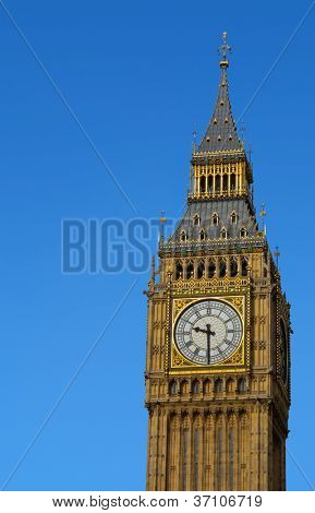 Big Ben Westminster Palace Elizabeth Clock Tower in London with a blue sky.