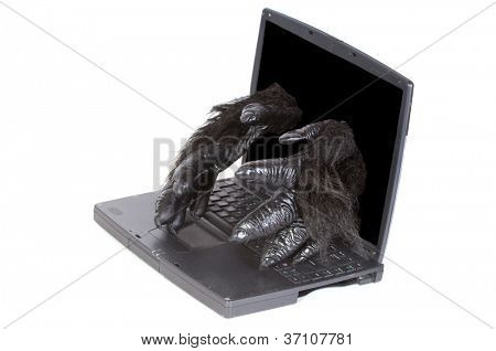 humorous image of Gorilla within (the operating system software) self repairing a computer