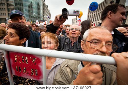 MOSCOW - 15 SEPTEMBER: Opposition activists and supporters take part in an anti-Putin protest rally on September 15, 2012 in Moscow. Thousands of opposition supporters are expected to march in Moscow.