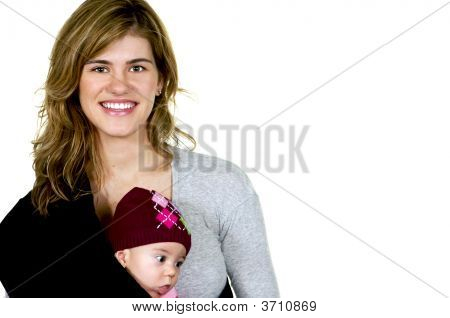 Young Mom With A Cute Baby Girl In A Sling