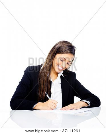 Confident happy businesswoman signing contract at her desk isolated on white background