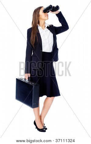 Business vision concept with businesswoman looking through binoculars while wearing a suit and with briefcase isolated on white