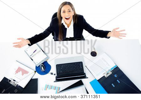 overwhelmed businesswoman is stressed and overworked at her desk office job