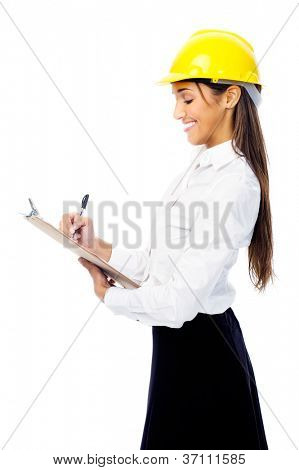 Businesswoman with safety helmet hardhat and clipboard for surveying construction industry isolated on white background