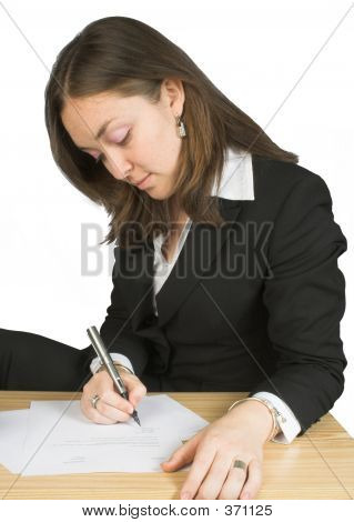 Business Woman Signing Papers
