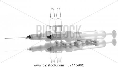 syringes monovet, ampoules and pills isolated on white