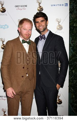 LOS ANGELES - SEP 21:  Jesse Tyler Ferguson, Justin Mikita arrives at the Primetime Emmys Performers Nominee Reception at Spectra by Wolfgang Puck on September 21, 2012 in Los Angeles, CA