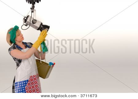 Woman Cleaning Photo Studio