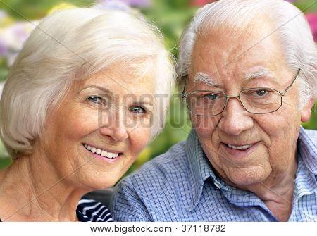 Happy senior couple portrait,outdoors,close-up