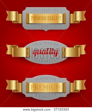 Decorative emblems of quality with golden ribbons - vector illustration