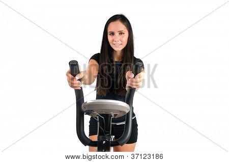 Youn girl on gym bike