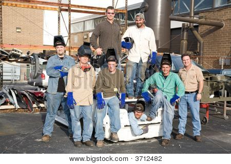 Factory Workers And Supervisor