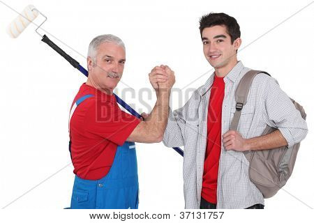 Experienced tradesman making a pact with his new apprentice