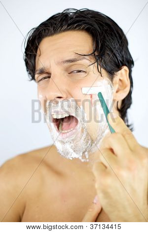 Man Shouting While Shaving Cutting With Blade