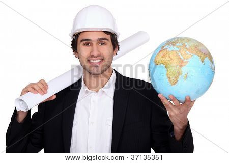 Man holding a plan and a globe