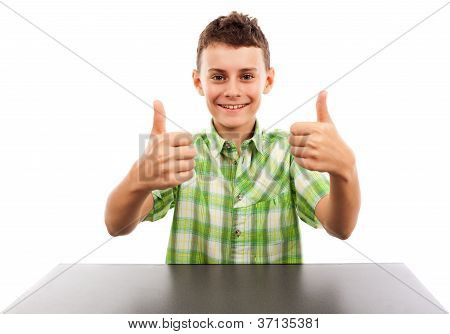 Schoolboy At His Desk With Two Thumbs Up