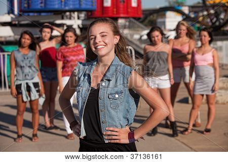 Smiling Girl With Hand On Hips