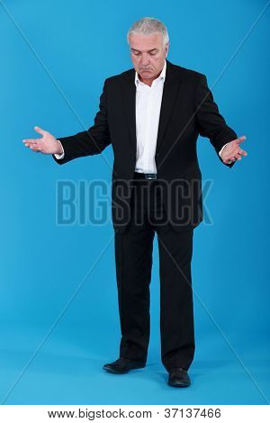 Bemused senior businessman