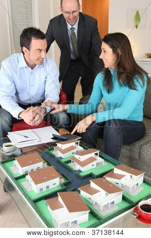Potential buyers looking at a housing model