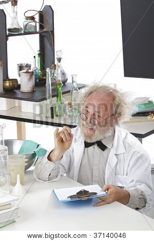 Friendly Scientist In Lab Makes Notes On Clipboard