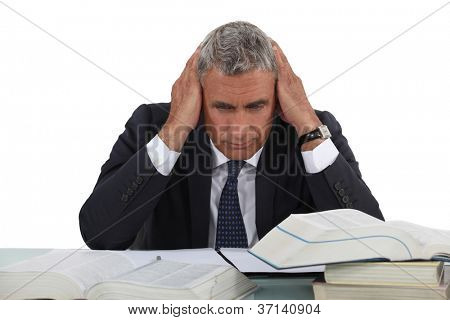 Businessman hitting the books