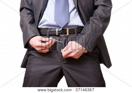 Young Businessman mockingly Pulls A Usb Cable off His Pants.