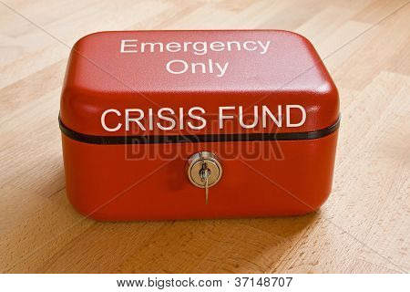Closed Red Cash Tin Marked  Crisis Fund - Emergency Only