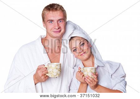 young family drinking tea in the morning