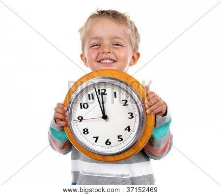Smiling nursery school child holding a clock