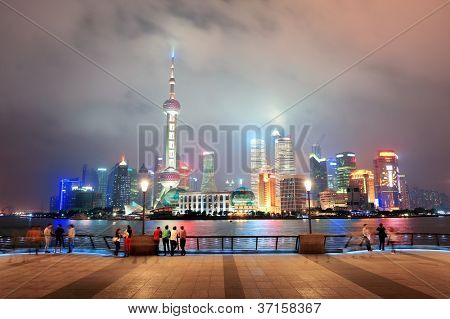 Shanghai urban city skyline over walkway at night