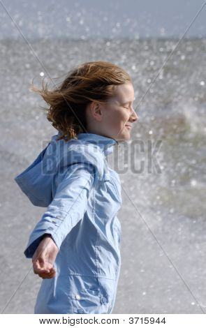 Girl Stands At Baltic Sea