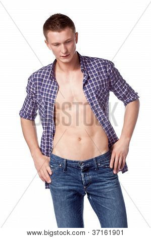 sexy handsome man posing with unbuttoned shirt