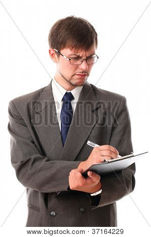 Serious businessman write something over white background