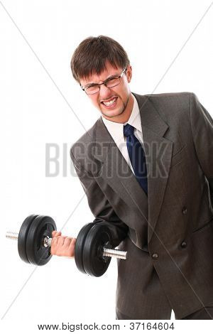 Weak businessman lifting a dumbbell over white background