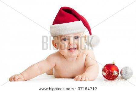 Baby boy in Santa's hat lying isolated on white
