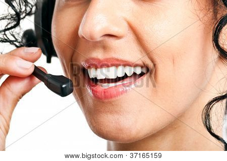 Closeup portrait of a happy young call center employee smiling with a headset