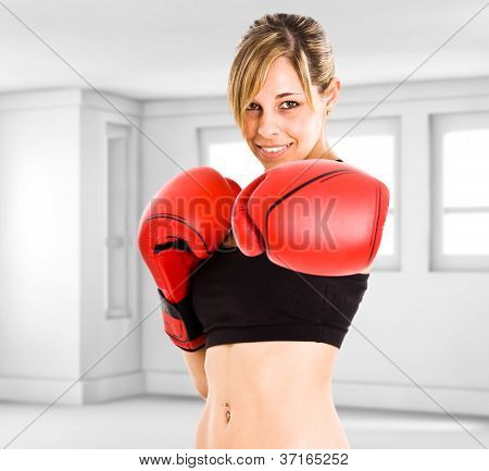 Young beautiful female boxer portrait