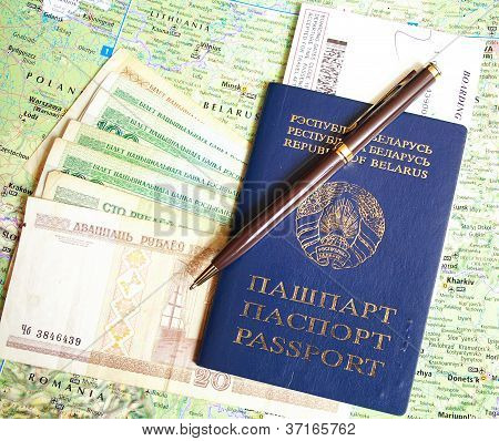 Belarusian passport and money over map