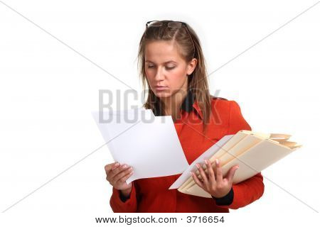 Beautiful Young Business Woman Reading Files