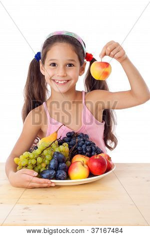 Girl with apple and plate of fruit