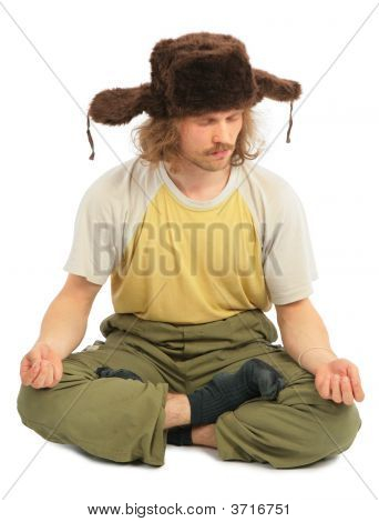Meditating Long-Haired Russian Man In Cap With Ear-Flaps