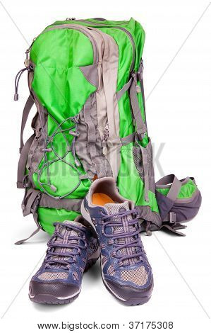 Pair Of Hiking Shoes And Backpack Isolated On White Background