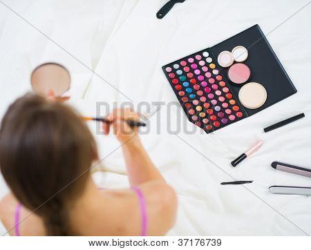 Girl Applying Makeup. Upper View