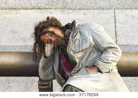 Unidentified Man Sleeps On A Bench In The City Centre