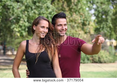 Good looking man showing something to his girlfriend