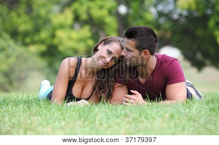 Portrait of a young couple lying on the grass