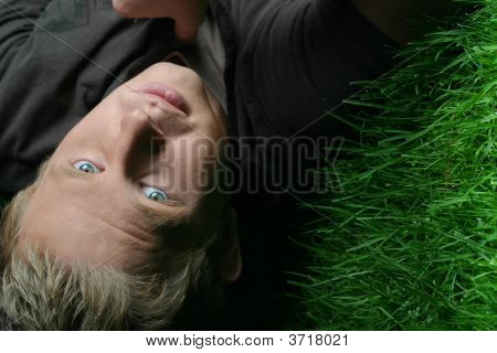 Blond Guy On Grass